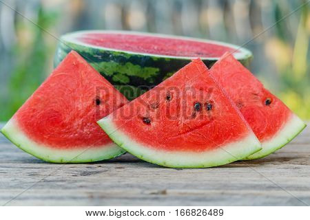 water melon slice on wood texture in nature background.
