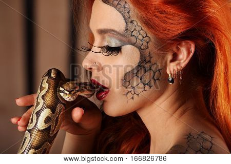 Nude Portrait Of Lovely Young Woman With Orange Python