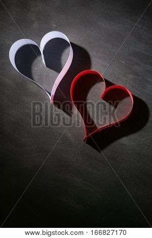 Postcard To Valentine's Day. White And Red Heart Made Of Paper Strips. Dark Background.