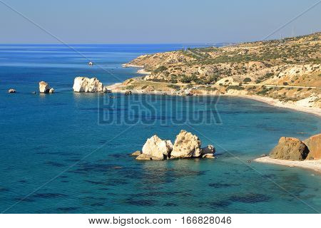 PETRA TOU ROMIOU, CYPRUS: General view of  Aphrodite's rock and beach near Pafos