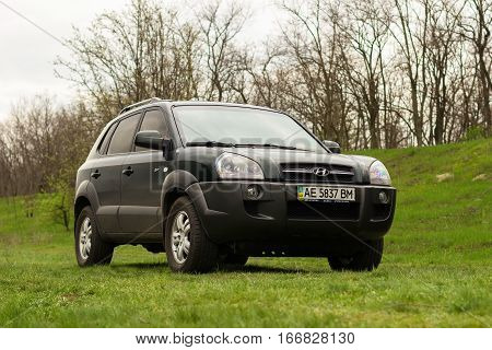 PERESHCHEPINO, UKRAINE - APRIL 20 2014: HYUNDAI TUCSON IN NATURE