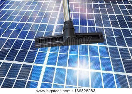 Close-Up Of A Cleansing Tool On Shiny Solar Panel Roof. Sustainable Energy Concept