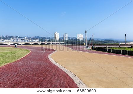 Beachfront Promenade Against Mgeni River Bridge And Blue Skyline