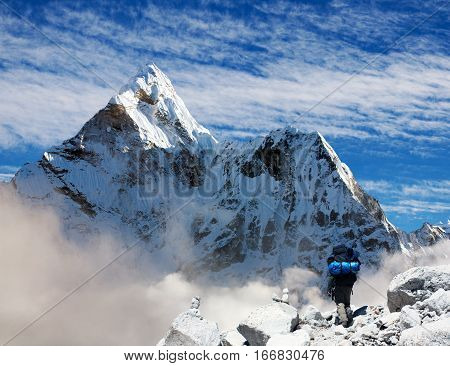 Beautiful himalayas mountain view of mount Ama Dablam with tourist and beautiful clouds - Sagarmatha national park - Khumbu valley - Trek to Everest base camp - Nepal