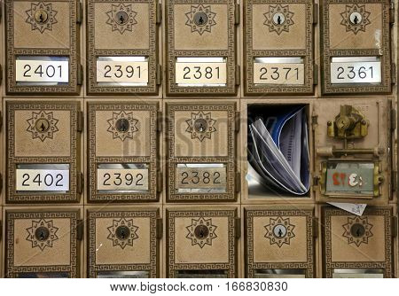 vintage post office boxes with mail
