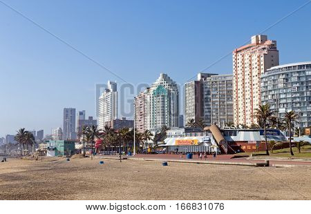 Early Morning Beach Against City Skyline In Durban