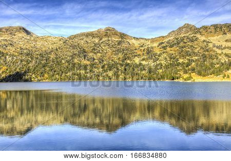 Reflection of mountains pekas in Lac d'Aubertlocated in Pyrenees Mountains in Neouvielle Massif.