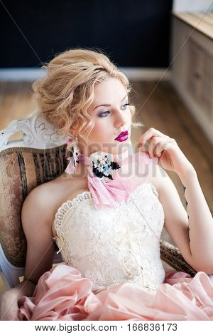 Fashion photo of beautiful girl wearing handmade accessories. Professional make-up and hairstyle. Perfect skin. Fashion photo. Baroque style.