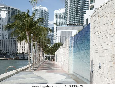 The view of Miami Riverwalk with downtown skyscrapers in a background (Florida).