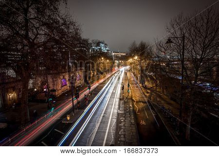 London, UK - January 25, 2016: Light car streaks as seen from the top of Golden Jubilee bridge at embankment station