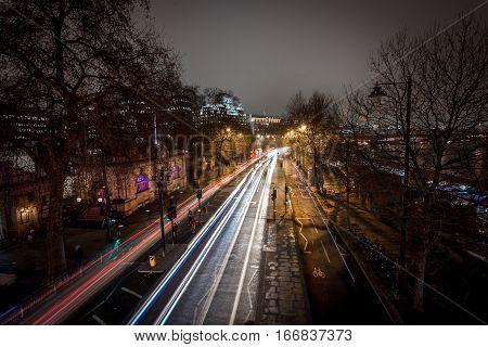 London, UK - January 25, 2016: Light car streaks as seen from the top of Golden Jubilee bridge at embankment station