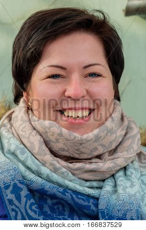 Portrait of happy unprofessional adult brunette model with a big smile close up, short hair and winter clothes