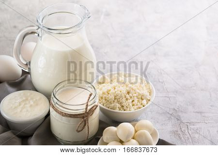 Selection of Dairy products. Cottage cheese or curd yogurt Sour cream milk and mozzarella concrete table.