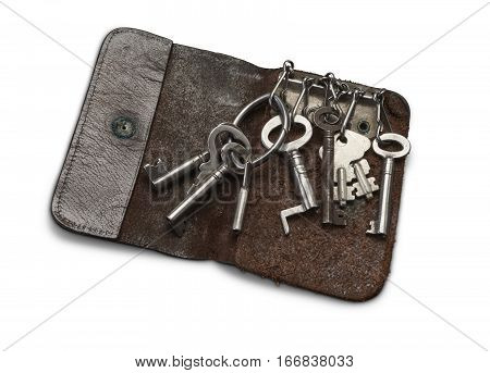 Old keys in key in leather key wallet isolated on white