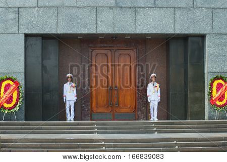 HANOI, VIETNAM - JANUARY 10, 2016: The soldiers of the Vietnam people's army on guard at the door of the Ho Chi Minh mausoleum