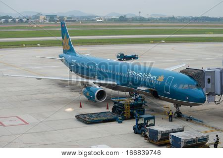 HANOI, VIETNAM - JANUARY 12, 2016: preparation of a Airbus A321 (VN-A602) with Vietnam Airlines before departure at the airport Noi Bai