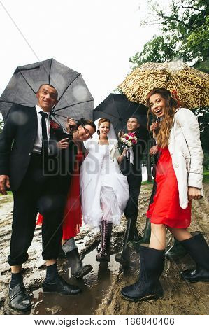 Newlyweds Have Fun Posing With Friends In The Gumboots