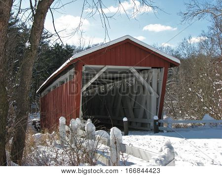 Red Everett Road Covered Bridge on a sunny winter day