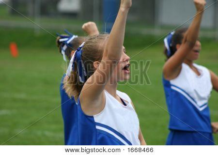 Youth Teen Cheerleader Cheering at Football Game