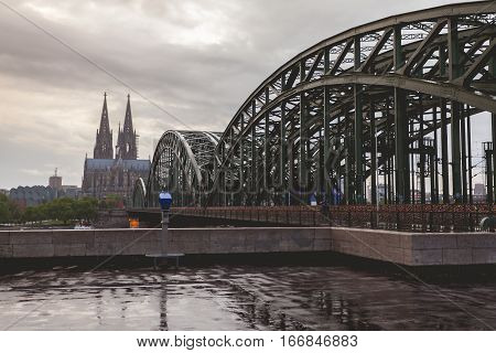 View on Cologne Cathedral and Hohenzollern Bridge, in the rain. Germany. Panorama of the city