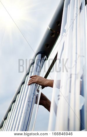 Man installing solar collector tube. They are used to collect energy.
