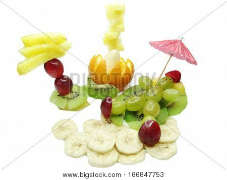 creative fruit dessert for child funny form man relaxing on the beach