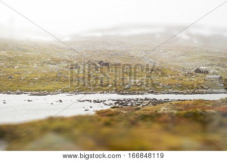 Landscape of Norway, mountains and shed, view from train