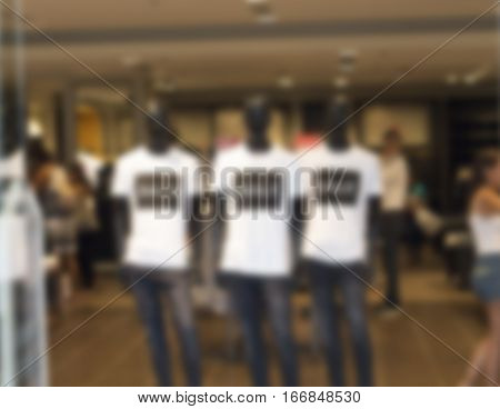 Department store blur photo background. Shopping mall defocused photo for banner template or backdrop. Sale season blurry image. Shopping window in blur. Clothes retailer mannequins bokeh image