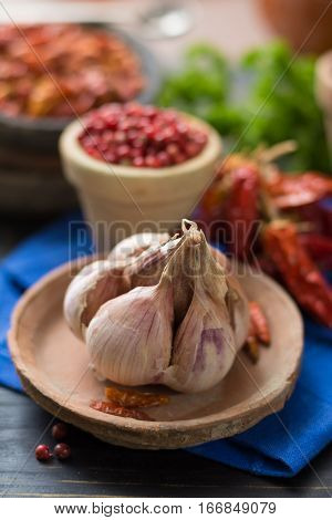 French garlic and red hot chili cayenne peppers dried variety - spicy ingredient on wooden table