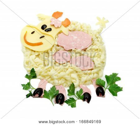 creative vegetable food meal with spaghetti and sausage cow form