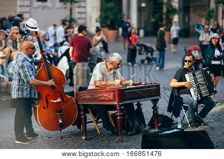 Rome, Italy - June 3, 2016: Street Musicians Playing Their Instruments