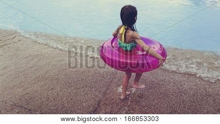 Little Girl Holding Swimming Buoy Playful Pool Happiness