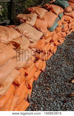 Orange sandbags stacked and ready to use for wall