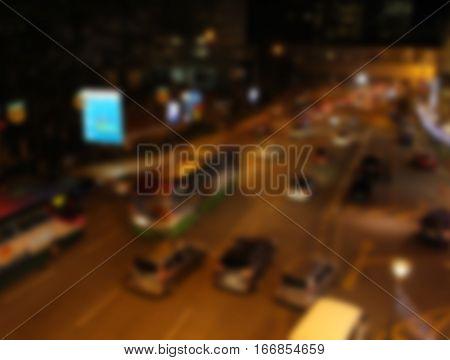 Night highway view in blur. City street blurry photo. Streetlife bokeh image. Street view with billboards and cars defocused image. Road in big city bokeh image. Night city lifestyle blurry background