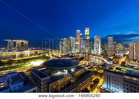 Singapore Central Business District and Marina Bay along Singapore River during evening twilight blue hour