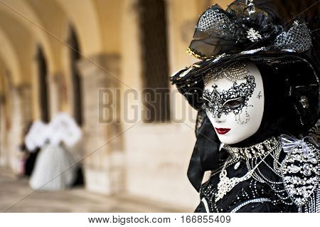 A elegant woman with a carnival dress for the carnival in Venice. Italy.
