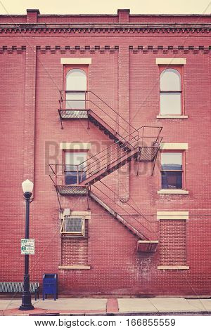 Color Toned Building Wall With Fire Escape Stairs, Usa