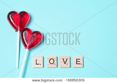 Two lollipops. Red hearts. Candy. The word