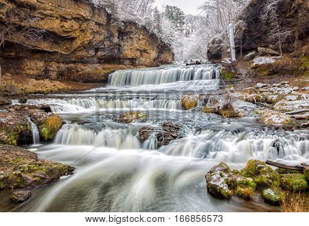 Willow River Falls after first seasonal snow near Hudson Wisconsin USA.