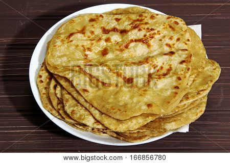 Whole wheat Paratha an Indian bead fried on a pan