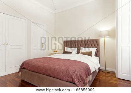 Brightly Lit and Fresh Bedroom Suite With Hardwood Floor