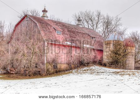 Aging Distressed Barn In Winter