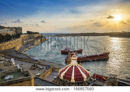 Valletta Malta - Sunrise at the Grand Harbor of Valletta the capital city of Malta with blue sky and ships