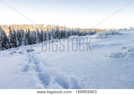 Snow covered hills in mountains in winer