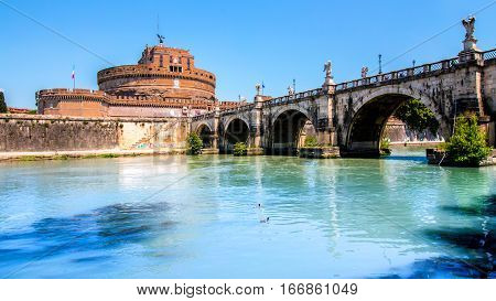 view of Castel Sant'Angelo from under the bridge over the Tiber in Rome Italy