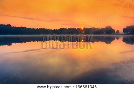Beautiful Sunrise Over Foggy Springtime Lake