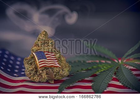 Cannabis bud, leaf and american flag with smoke and copyspace - veteran theme medical marijuana concept