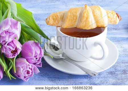 Cup Of Tea Bouquet Of Tulips And Croissants