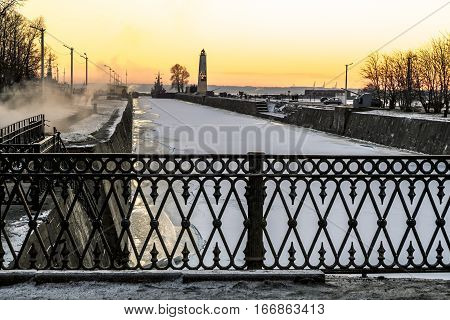 Kronstadt .Russia.January 7 2017. view of Petrovsky dock Canal and a Wooden lighthouse at sunset in Kronstadt.