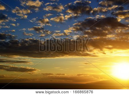 Blue sky with sunbeams and clouds.Sunset sky background.Cloudy sunset sky as a background.